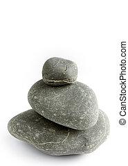 Three river rocks on plain background