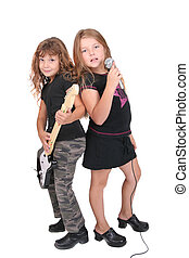 rockstar children - two young female childred playing guitar...