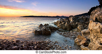 Panoramic view of the rocky Adriatic coast the evening ...