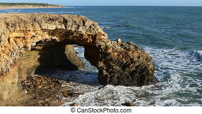 Rocky arch on the coast of la Pointe du Payre in Jard-sur-...