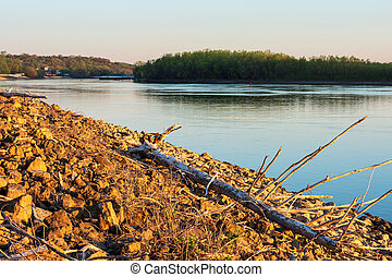 Rocky banks of mississippi river at dawn