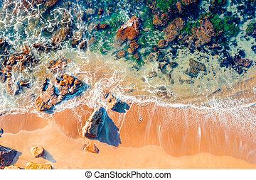 Rocky beach abstract aerial