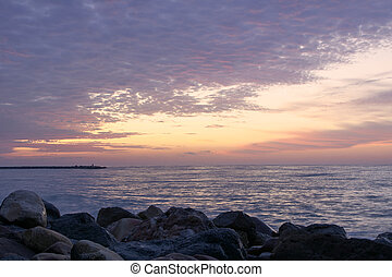 Rocky beach at sunrise, colors