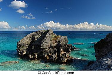 rocky beach - cliffs and rocks on a tropical shoreline