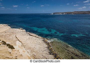 Rocky beach in Marsaskala Rocky beach in Marsaskala gulf, Malta.