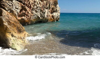 Rocky beach in the Mediterranean Sea. Clean water, sun,...