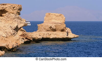 Rocky Beach on Red Sea with Cliff near the Coral Reef. Egypt. Resort on Red Sea Coast.