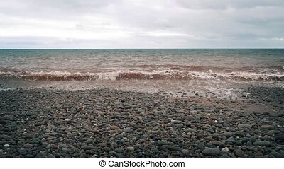 Rocky Beach - Rocky beach shore with calm sea