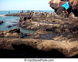 Travellers on a rocky beach