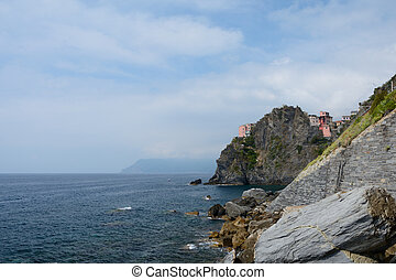 Rocky cliff and buildings in Manarola
