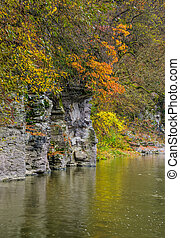 rocky cliff of mountain river background in autumn. colorful...