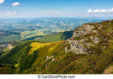 rocky cliff on the edge of mountain hill. gorgeous view in...