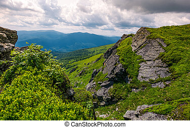 rocky cliff on the hillside edge. spectacular view of...