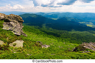rocky cliff over the grassy valley. beautiful summer...