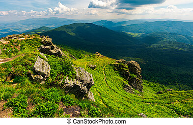 rocky cliff over the valley. beautiful mountain landscape in...