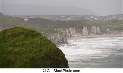 Rocky cliffs in Ireland - A steady scenic shot of a cliff in...