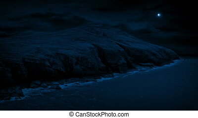 Rocky Coast At Night - Rocky coastal landscape on moonlit...