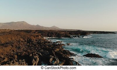 Rocky coast of Atlantic Ocean on island of Lanzarote, aerial