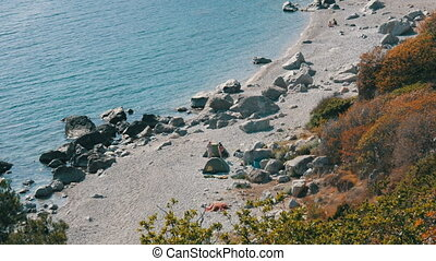 Rocky coast of the Black Sea on which there are few people...