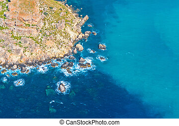 Rocky coast of the island by the sea, aerial view.
