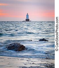 Rocky Coastal Lighthouse Seascape at Sunset