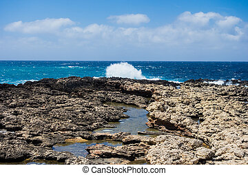 Rocky coastline and waves in Malta.