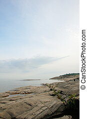 Rocky coastline - Lake viewed from the rocky coastline close...