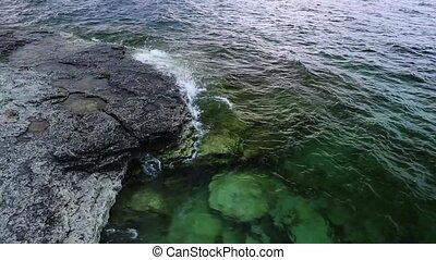 Rocky Coastline Loop - Clear, aquamarine waves on Lake...