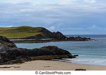 rocky coastline with sandy beaches