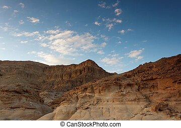 Rocky desert landscape at sunset in Negev, Israel