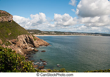 The view of the sea next to a rocky hill, Plettenberg Bay, South Africa