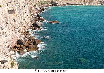 Rocky hills bathing in the ocean