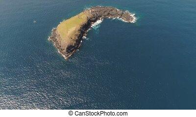 Rocky island in the ocean. - Lonely rocky island in the sea....