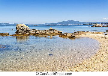 Rocky islet on the beach