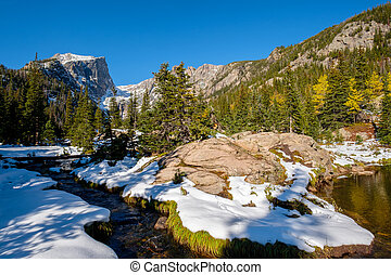 Rocky Mountain National Park in snow at autumn - View on...
