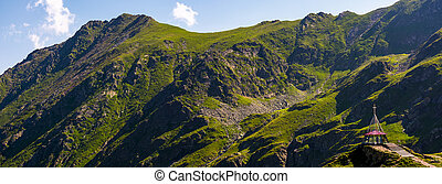 rocky mountain ridge with grassy slopes. lovely nature...
