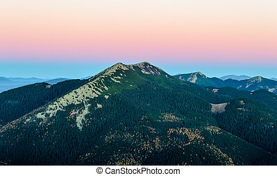 Rocky mountain top in the dawn