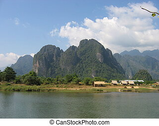 Rocky Mountains and clear Mekong river waters. Vang Vieng. Laos
