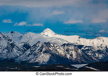 Rocky Mountains with the Banff townsite below in Banff National Park, Alberta, Canada.