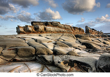 Rocky Ocean Lookout - Rocky lookout at Yamba beach against a...