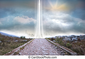 Rocky path leading to light beam