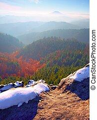 Rocky peak above inverse mist. Winter cold weather in...