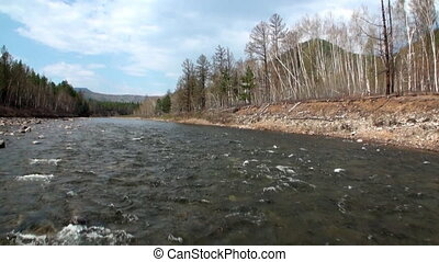 Rocky river bank in Mountain in Siberia of Russia. Border of...