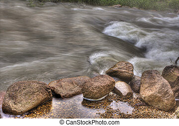 Rocky River Rapids in HDR - Unsettled fast flower river...
