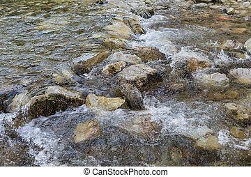 Rocky rough river with stones