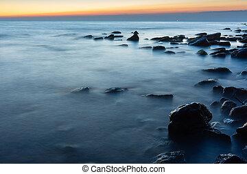 Rocky sea beach after sunset, Black Sea, Anapa, Russia