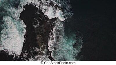 Rocky seashore landscape - Sea waves are crashing on the...