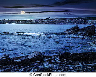 rocky shore and a beach of Black sea at night - Rocky shore...