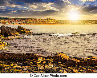 rocky shore and a beach of Black sea at sunset - SOZOPOL,...