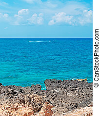 rocky shore and blue water